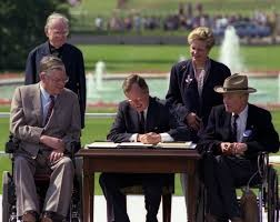 Image of President George H.W. Bush signing the Americans with Disabilities Act