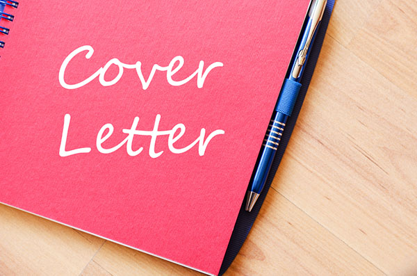 "Image of a pen with a notebook with ""Cover Letter"" written on it"