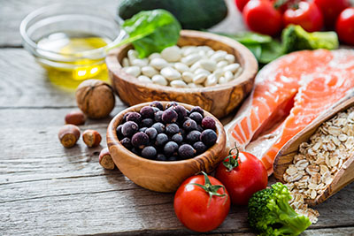 Picture of healthy food, including salmon, nuts and more on a table