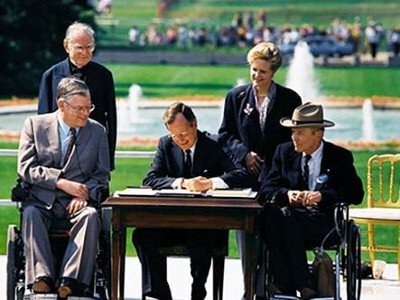President George H.W. Bush passes into law the ADA