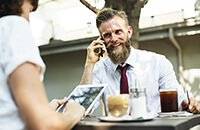Man on phone smiling