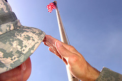 image of soldier saluting US flag