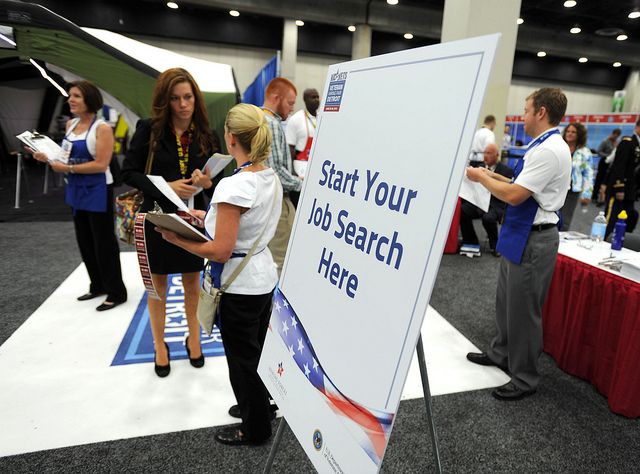 Start Your Job Search Here sign on an easel at a hiring fair