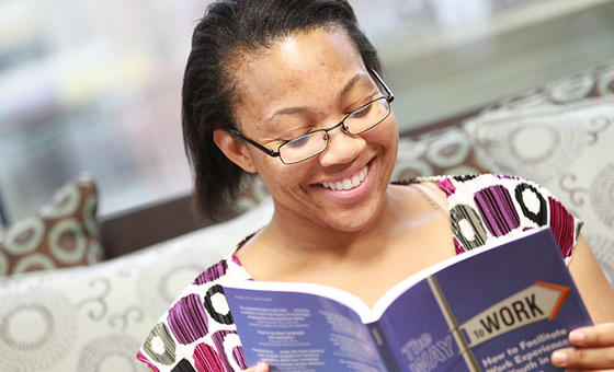 Ticket to Work Success Story participant Megan Riggs flipping through a book