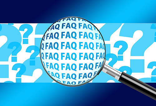 magnifying glass circling multiple instances of the acronym FAQ
